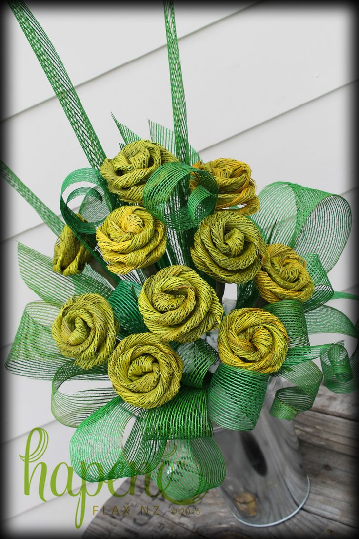 Hapene flax flower arrangement with 10 gorgeous large yellow Hapene flax roses in a tin vase.