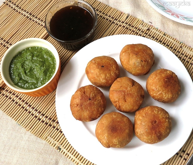 'Aloo-Kachori' / Potato-Puffs -  Crisp home-made pastry shells stuffed with  mint and potato mixture. 'Aloo- Kachori' is a popular snack in North India, with a few different versions to suit regional tastes.