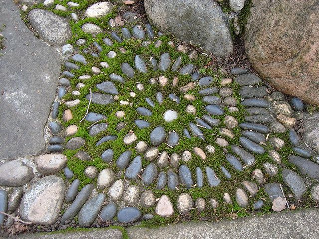 cool garden spiral design with stones and moss:  Mossy Spiral by Rozanne, via Flickr