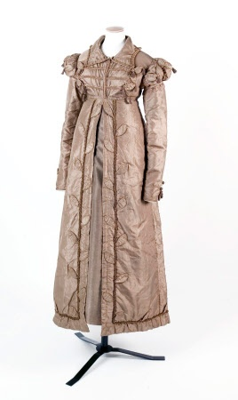 Silk pelisse, 1818-20. A fawn silk carriage dress pelisse, with frogged front, Cap sleeves over long sleeves. Tasselled decorations.