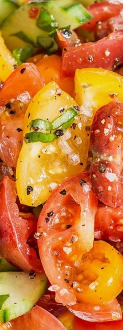 Cucumber Tomato Salad ~ Fresh cucumbers, juicy tomatoes, and basil are drizzled with a balsamic and oil dressing for a flavorful finish... Perfect for a casual dinner or for feeding a crowd at a potluck.