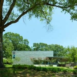 Duvall Decker clads a Mississippi dwelling in grey-green slate shingles