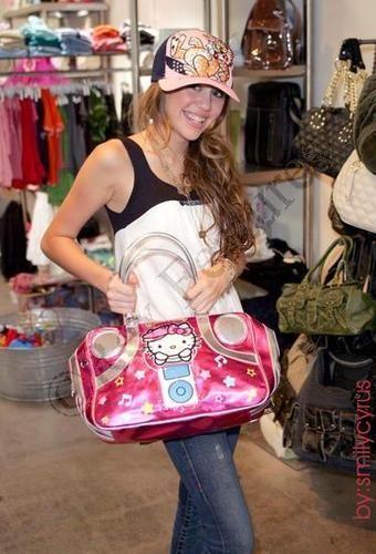 Miley Cyrus with Hello Kitty bag