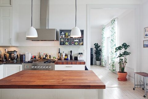 I love to cook, and this kitchen is clean, bright, and open. I love the island's wood and the easy access to all the essentials.