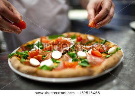 chef making pizza at kitchen - stock photo