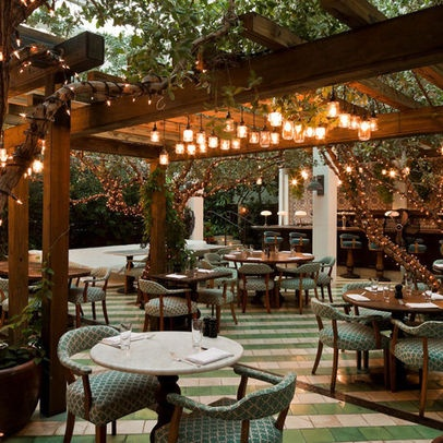 The seats and tables leave much to be desired but I am in love with the clustered lighting in the middle and the just so overgrown arbors. The tile isn't so grand either, I like the amount of space to move about and the full wood and plant ceilings. Just lovely.