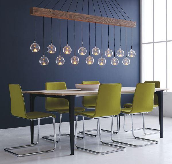 Look at that lighting! Sprout green dining chairs