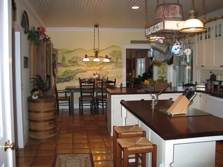 country kitchen with mahogany countertops, teracotta floor custom off white cabinets! Love everything about this!