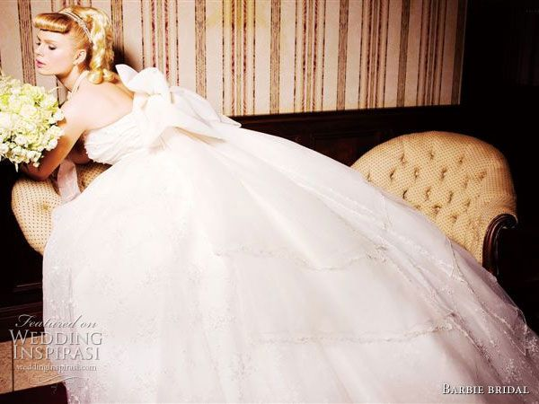 fluffy ballroom dresses with ruffles | White wedding dress with a ball gown silhouette from Barbie Bridal