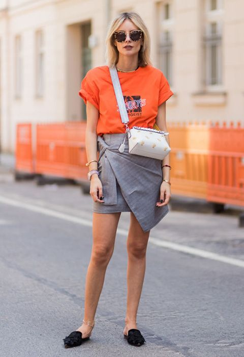 Blogger Lisa Hahnbück wearing an orange tee with a smart skirt | ASOS Fashion & Beauty Feed