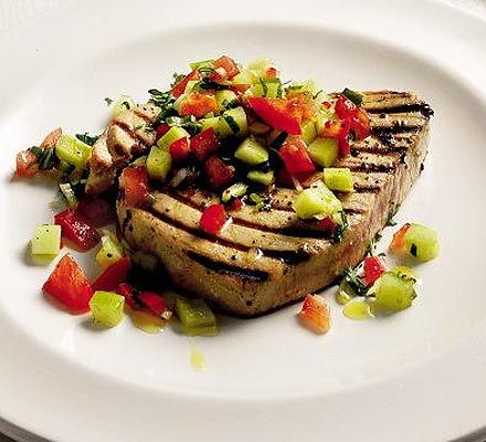 Tuna steaks with cucumber relish also with coriander pesto here: http://www.eatyourbooks.com/library/recipes/818555/grilled-tuna-fish-steaks-with