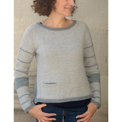 This pullover is worked from the top down, in the round, and in one piece with compound raglan sleeve shaping.It is a basic wardrobe piece with unique charm that plays with stripes in an unexpected way and includes interesting details such as an inset pocket, side vent with placket, ballet neckline, and garter stitch edges.