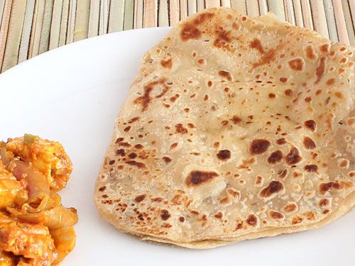 Parat Paratha 1¼ cup (for dough) + 1/2 cup (for dusting) Wheat Flour 1 teaspoon Cumin Seeds 2 teaspoons + for shallow frying Oil 1/2 cup Water Salt Butter