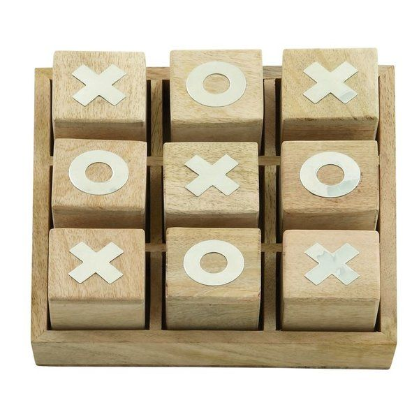 Toy around with your coffee table display and use this tic-tac-toe set as an on-trend complement to your seating group aesthetic. Featuring metallic numerals embellished on wooden cubes, this bold game set effortlessly draws attention and offers a whimsical alternative to a traditional centerpiece. For a relaxed, cozy, and technology-free afternoon, scatter plush floor pillows around the coffee table and drape throw blankets on your sofas, then gather around to play with this set and other…