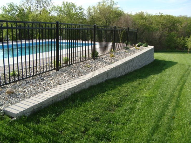 Inground pool raised up on armour stone google search for Pool design retaining wall