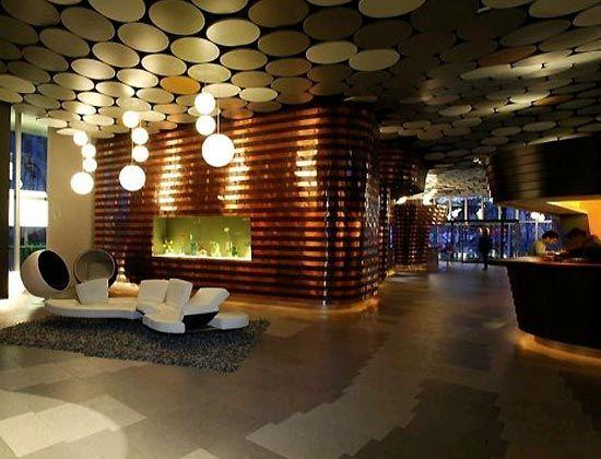 hotel lobby design | Modern warm hotel lobby lighting design | Architecture, Interior ...