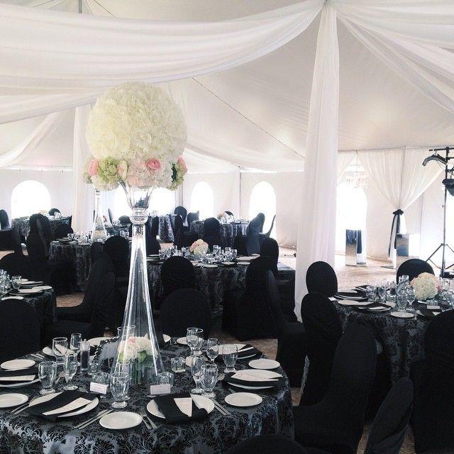 White rose ball, black and silver damask tablecloths. Decor by Unico Decor Inc. www.unicodecor.com