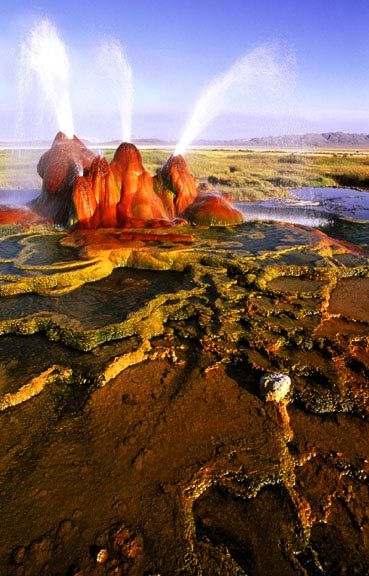 The continuous Fly Geyser of Fly Ranch is on private land in Nevada and began during 1916 [water well drilling that accidentally penetrated a geothermal source)