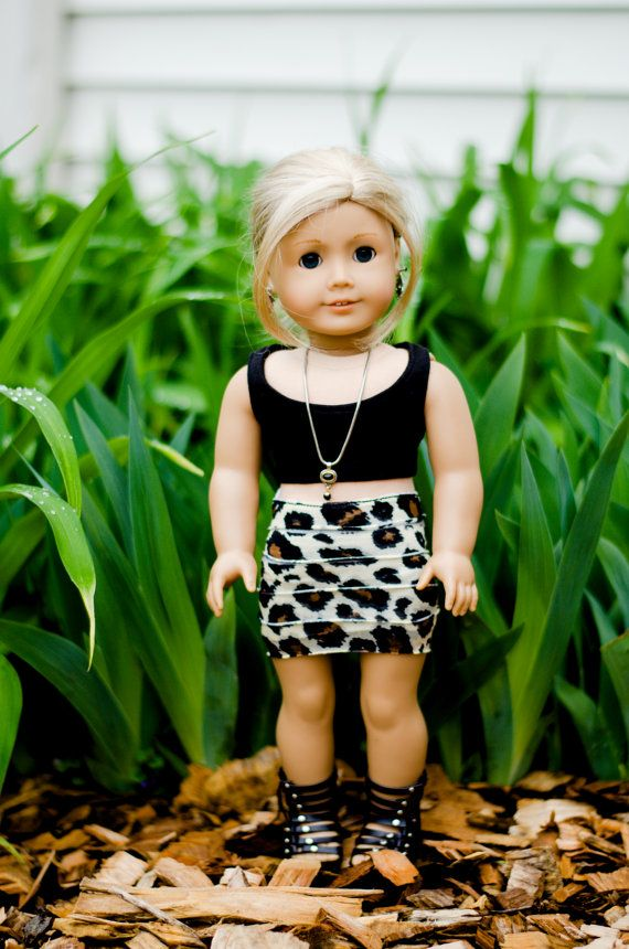 Cheetah Print Tiered Lindsey Mini Skirt for AG by EmilyHeatherDesigns via Etsy, $6.00 Being creative. imaginative, and original is good and this is a cute outfit on another type of teen or fashion doll--but these kind of outfits for American Girl upset me. AG dolls are supposed to be girls who are 9 turning 10 years old. Would you want this on your 10 year old? Just the old boring Barb M.