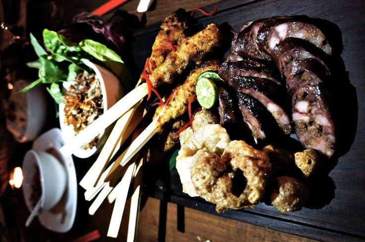 All porks - pork sausage, pork sate lilit (Balinese skewers) and pork skin crackers. Photo by Raditya Margi