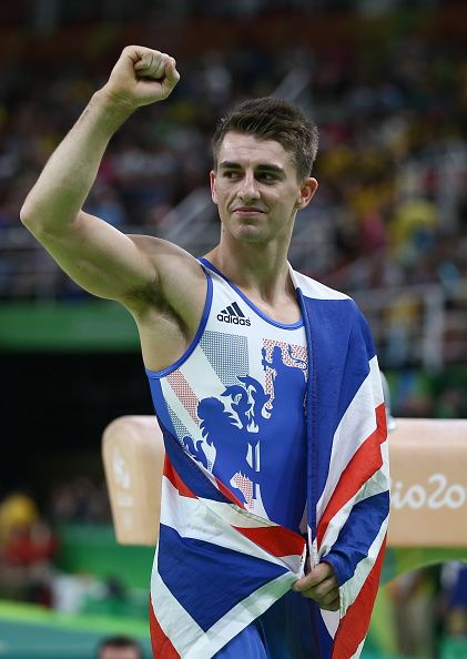 Artistic gymnast Max Whitlock of the United Kingdom reacts after winning the…