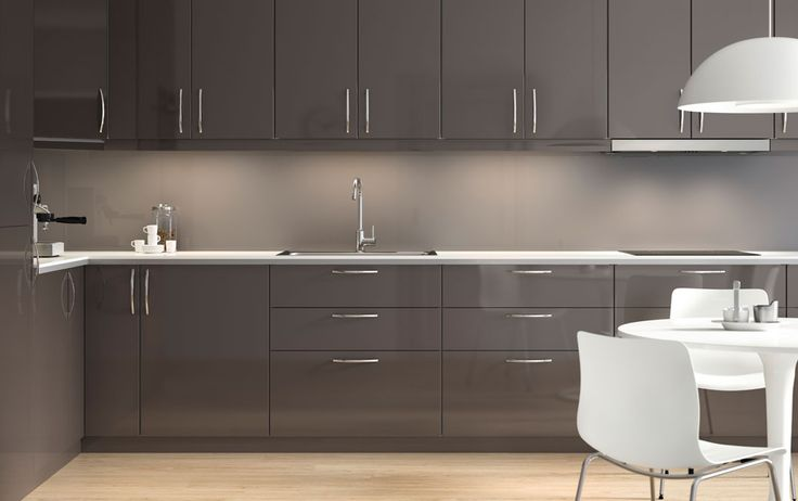 Modern high-gloss grey IKEA kitchen with light worktops and integrated appliances