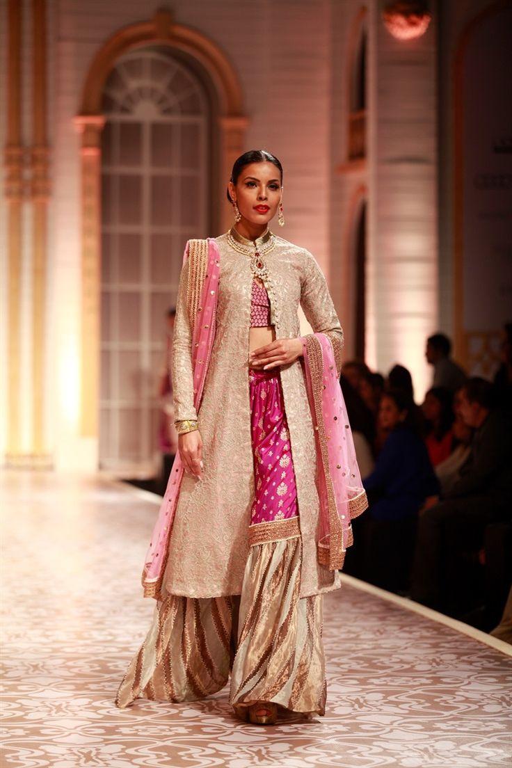 love these magenta 70s pants and the long jacket - Meera & Muzaffar Ali India Bridal Week