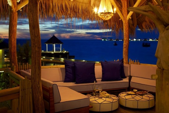 The generous #cushions and dim #lighting allow guests to make the #Treehouse an intimate or livelier setting at Viceroy Maldives.