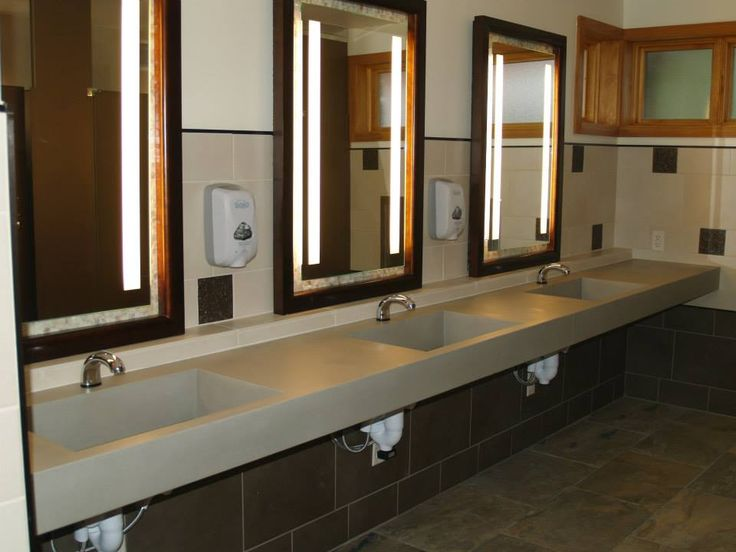 This is an awesome piece we created for the Olbrich Botanical Gardens. It features three integral ramp sinks and gives the bathroom a modern, stunning look. Check it out!
