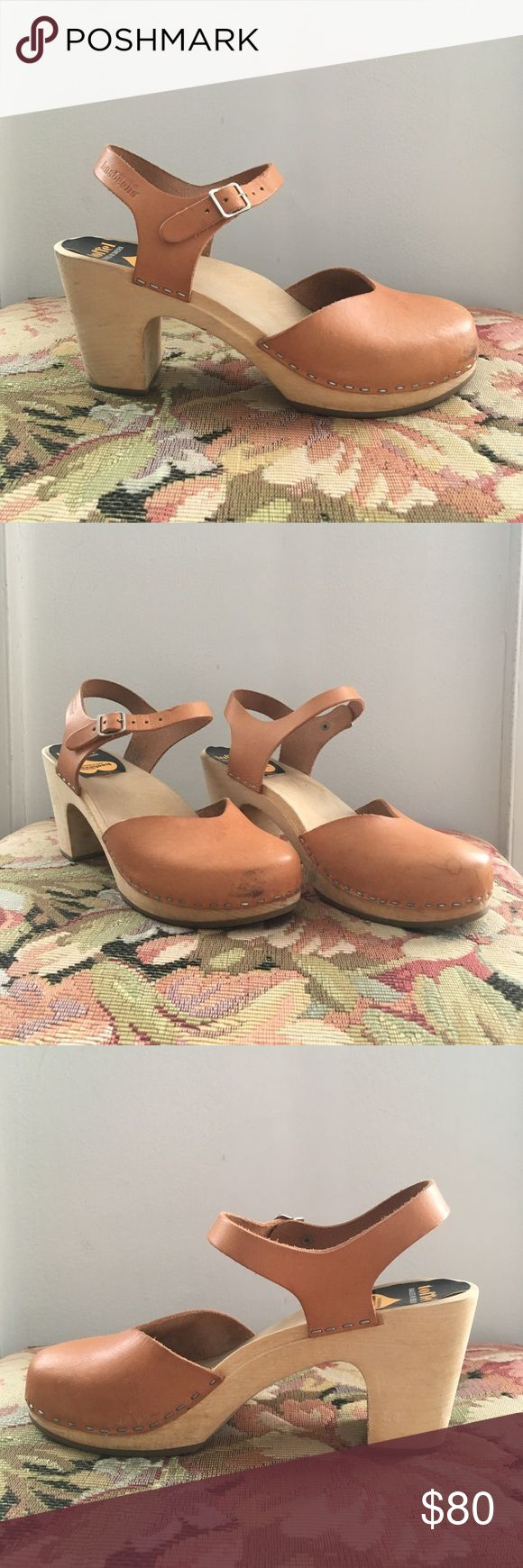 """Swedish Hasbeens Tan Closed Toe Heels Clog Sandals Swedish Hasbeens tan closed toe wood and leather clog heels with rubber soles. Heel height is 3.3"""". Size 41. These are used, see photos for scuff marks and water damage. Swedish Hasbeens Shoes Mules & Clogs"""