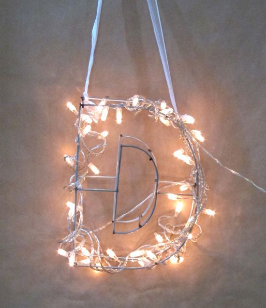 DIY Wrap white Christmas lights to the boxwood letter #initials #letters #lighting #christmaslight #creative #inspired #party #decor #trend