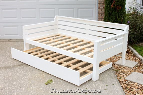 Handmade Daybed and Trundle. Solid Pine wood with a white gloss finish.  Beautiful addition to any guest bedroom, nursery, or reading room.  Made to your specifications.