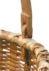 """Bushwhacker Basket  14"""" x 13.5""""  The Bushwhackers were native to a small area of New York state and their baskets were often confused with Shaker work. Their work is distinctive though and includes details not found in other baskets. An example of one of these is the notch in the swing handle shown in the detail photo."""
