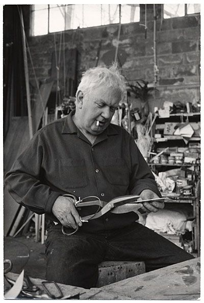 Citation: Alexander Calder cutting metal, ca. 1955 / unidentified photographer. Alexander Calder papers, Archives of American Art, Smithsonian Institution.