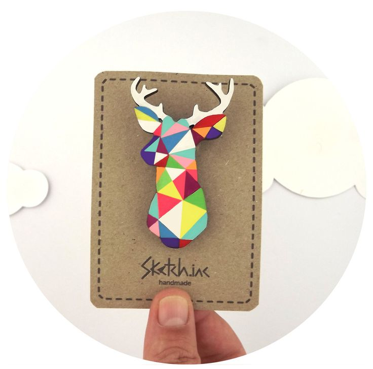 HARLEQUIN STAG BROOCHThis precious little Harlequin Stag will bring a bright touch of geometric heaven to your summer cardigan or winter jacket.He is made from laser cut Baltic Birch wood and hand painted with enamels and acrylic paints and finished with a hard wearing Satin Varnish.Each brooch is hand signed on the back and ships in their own gift box.Harlequin Stag measures 4cm x 6.5cmShipping:United Kingdom : £3.10Everywhere Else : £4.00