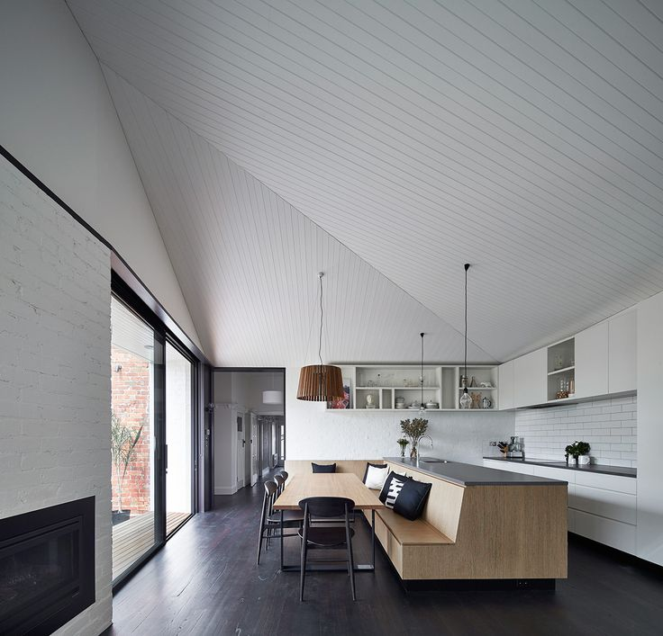 The addition to this Californian Bungalow in Balaclava has been carefully positioned to retain 2 existing trees and to catch the northern sunlight. New walls and boundary fences angle and shift in height to stitch into the existing site fabric and to create a series of walled courtyards that blur the boundary between inside and out.