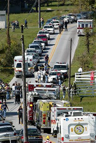 Emergency vehicles line White Oak Road, Monday, Oct. 2, 2006, in Nickel Mines, Pa., after a 32-year-old man took about a dozen girls hostage in a one-room Amish schoolhouse
