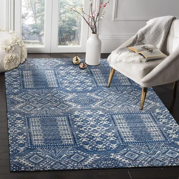 The Manisa 751 Navy Blue Patterned Transitional Designer Rug is a super stylish rug featuring traditional motifs in soothing blue tones:
