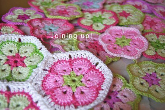 "this crochet block is ""African Flower"". Just like Granny Square, African Flower is a crochet block but in hexagonal shape, it can be joined next to each other to become a bigger piece and make into blanket, afghan, shawl, bag, table runner, cushion cover, soccer ball toy, coaster, pincushion, dress etc…. you name it!"