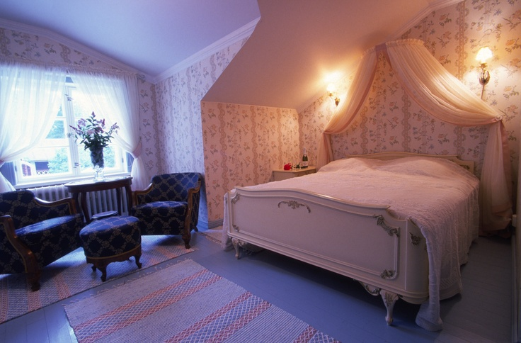 hand made rugs matched to atmosphere and colours of this romantic room