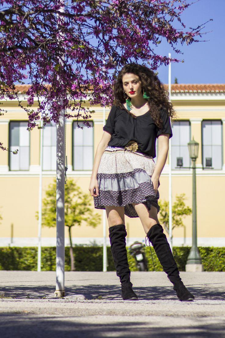 Spring outfit. Striped gitane skirt, overknee flat boots, crop top, statement belt and boho earrings.