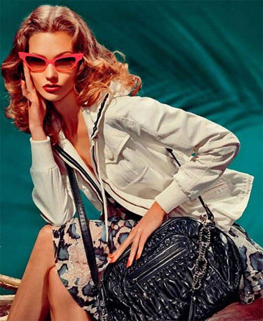 """Con aire retro en la forma estilizada(también al estilo """"ojo de gato""""), la firma francesa Dior reinventa un clásico de los anteojos de sol añadiéndole el intenso color rojo en la montura"""
