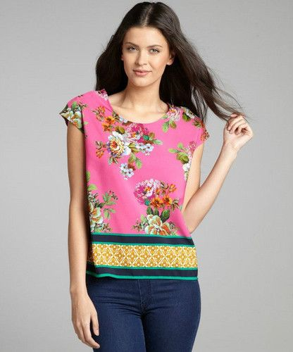 Ellen Tracy Pink Dahlia Print Blouse Size Medium and Large Sale Price $69.50ea. The Ellen Tracy blouse bursts with color that lends an artful design to the floral silhouette. Beautiful Dahlias, in vivid shades of Yellow, Pink and Green, cover both the front and back of this cheerful print. Ellen Tracy believes style comes not only from what you wear but what you do, who you are and who you aspire to be. We agree!