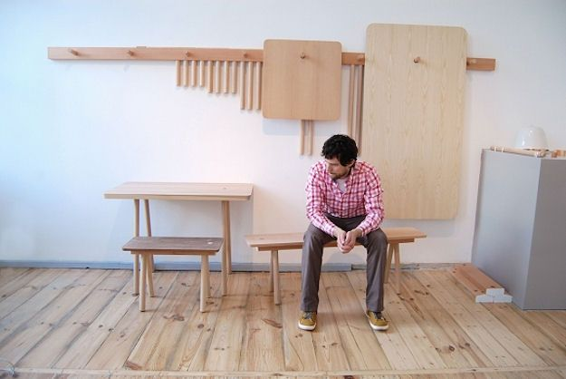 Tables and chairs that could be hanged on the wall, by StudioGorm