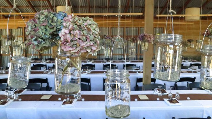 Rows of suspended jars at Criffel Station Woolshed. Now in our hire stock.