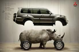 I found this example of visual metaphor to express the characteristics of the marketed car. By taking the rhino which is strong, tough, aggressive and protective. These traits are then expressed in the terms of the hidden and unknown for the rhino is placed underneath the 'Skin' of the vehicle.