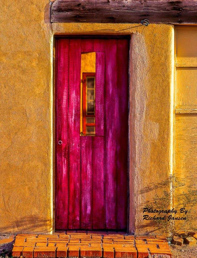 Taos, New Mexico      Luscious saturated marigold walls and frosted fuchsia door. Stunning.