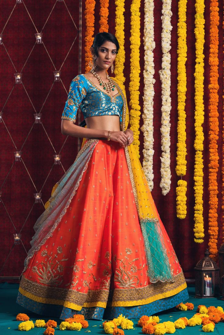 How great looking is the sunshine when you wear it and it comes out of you. Issa sunshine orange lehenga with azure blue silk hand embroidered blouse.<br> Jewellery Courtesy: Sitara Jewellery.They can customize the dress as per your requirement. For more detail . 19 February 2018