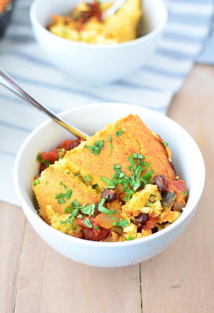 Black Bean Tamale Pie! This weeknight meal is healthy and filling! Black Bean and Zucchini Chili topped with homemade cornbread, baked to perfection! Vegan with Gluten-Free option   www.delishknowledge.com