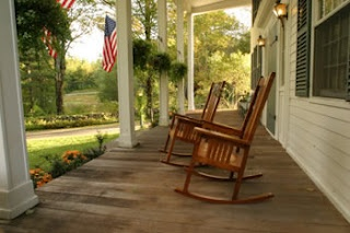 Wrap around porch with rocking chairs...perfect